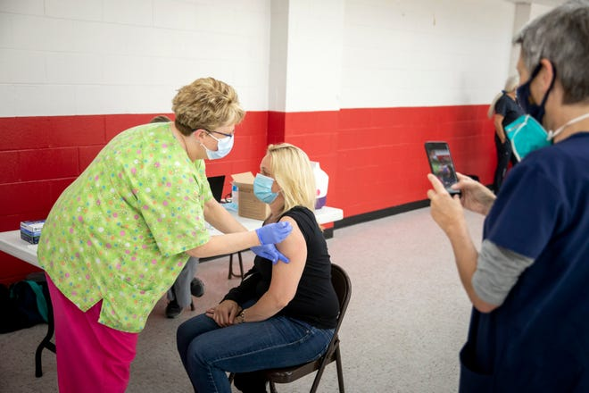 Hamilton County is looking into cash incentives for unvaccinated residents to get their shots.