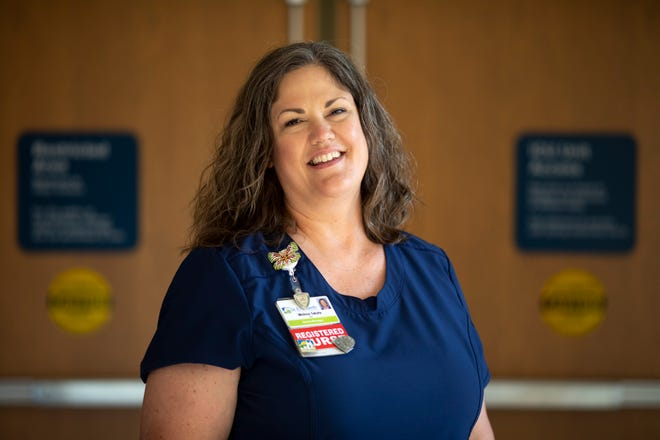 Melissa Takata, a St. Elizabeth-Fort Thomas hospital nurse supervisor, stands outside the ICU where most Northern Kentucky COVID-19 patients were treated at the height of the pandemic on June 22.