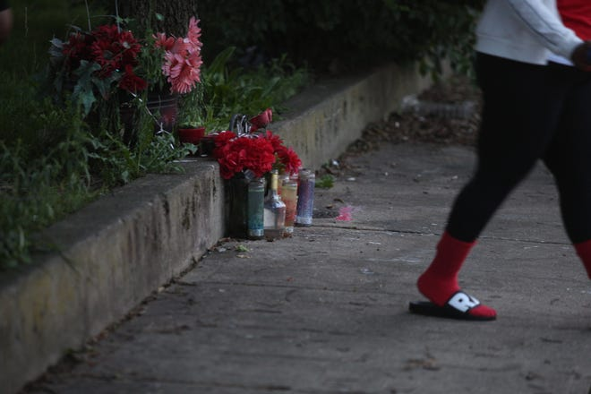 A memorial was setup for the person who was shot on Monday, June 21, 2021 near the intersection of Reading Road and Rockdale Avenue, in Avondale. In 2021, there have been at least 185 shootings in the city of Cincinnati.