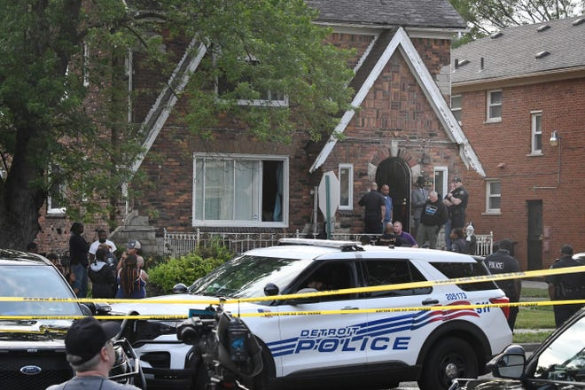 Police outside of 18003 Northlawn where two adults were found dead in Detroit, Michigan on June 21, 2021.