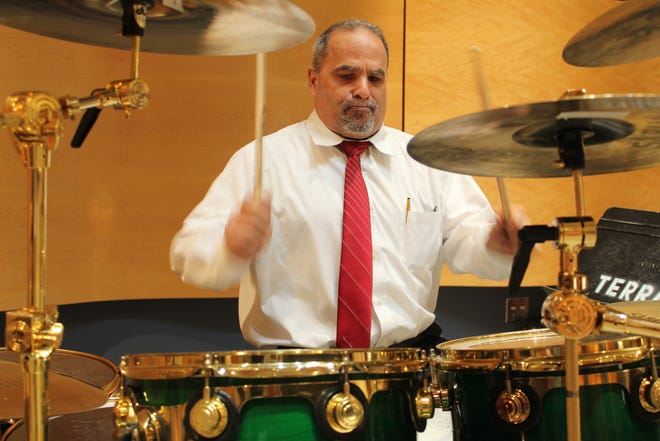 Michael Czeczele, Director of Musical Arts and Technologies at Terra State Community College, plays drums with the college's fusion ensemble, during a rehearsal in Terra State's recital hall. Czeczele said the college's music program has expanded and now has 11 different music ensemble groups.