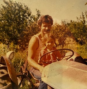 Jamie Jacobson in 1979 with daughter Jodie in Paonia Orchard.