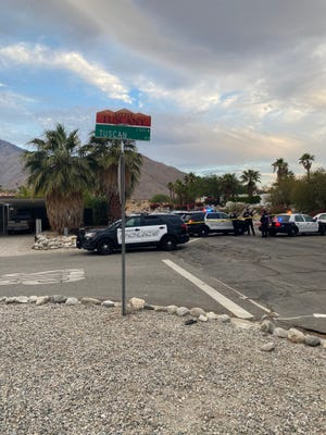 Police cars are on the scene of a shooting that left one person dead in a Palm Springs neighborhood on June 22, 2021.