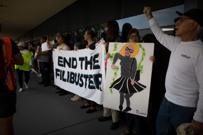 Ten people were cited for trespassingby Phoenix police during a planned demonstrationon June 22, 2021 outsideSen. Kyrsten Sinema's office urging the lawmaker to end the filibuster.