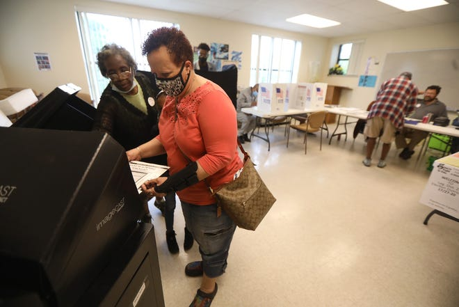 Debra Eabron gets help  casting her primary election ballot from election inspector Annie Gedeon at Aenon Missionary Baptist Church on Genesee Street on Tuesday, June 22, 2021.  One of the biggest races is the Rochester mayoral primary race with Mayor Lovely Warren and City Councilman at-large Malik Evans.
