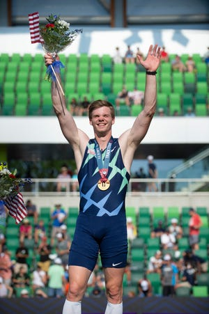 Pole vaulter Chris Nilsen, a South Dakota alum, waves to the crowd after winning gold at the US Olympic Trials.