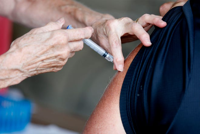 A man receives a COVID-19 vaccine in Springfield, Mo., which is seeing an average of 94 new COVID-19 cases per day, 93% of which are the Delta variant.