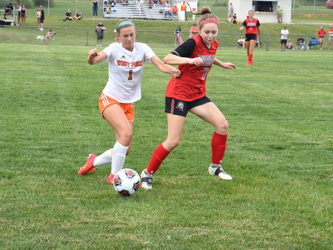Riverheads' Ysabel Fernandez and West Point's Campbell Bishop work to get the ball during the Class 1 state semifinals Monday, June 21.