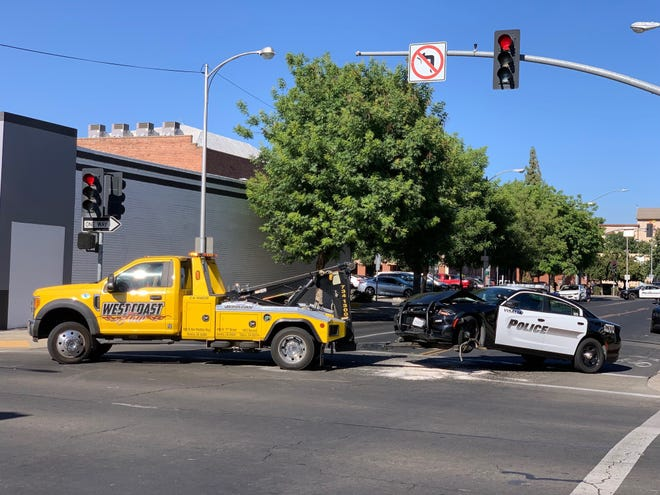 Visalia police are investigating the theft of an American ambulance that ended in a multi-vehicle collision in downtown Visalia on Monday, June 21, 2021.