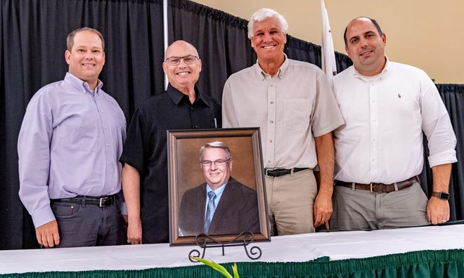 Visalia City Council members Brett Taylor, left, Mayor Steve Nelsen, Greg Collins and Brian Poochigian took a moment Monday, June 21, 2021 to recognize Vice Mayor Phil Cox before the meeting. He died Thursday after battling health issues.