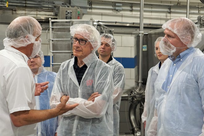 Master cheesemaker Steve Stettler leads Governor Tony Evers and DATCP Secretary-designee Randy Romanski on a tour of Decatur Dairy's cheese plant June 17, 2021.