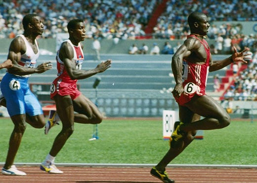 Ben Johnson of Canada, right, leads the pack to win the 100-meter dash finals in Olympic competition Saturday in Seoul.  American Carl Lewis is at center and Linford Christie, far left, of Great Britain was third. Johnson was later stripped of his medal after testing positive for steroids. Carl Lewis was given gold.