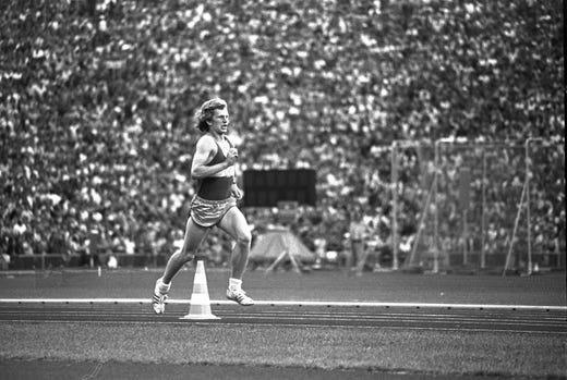 """A hoax student athlete enters the stadium at the end of the marathon at the 1972 Olympic Games in Munich, causing confusion for everyone including eventual winner Frank Shorter who followed on the track at the same time. Shorter was the third American to win the marathon, but it was the third time that an American would enter the stadium second. In 1904 and 1908, both """"winners"""" were disqualified for cheating and getting illegal help."""