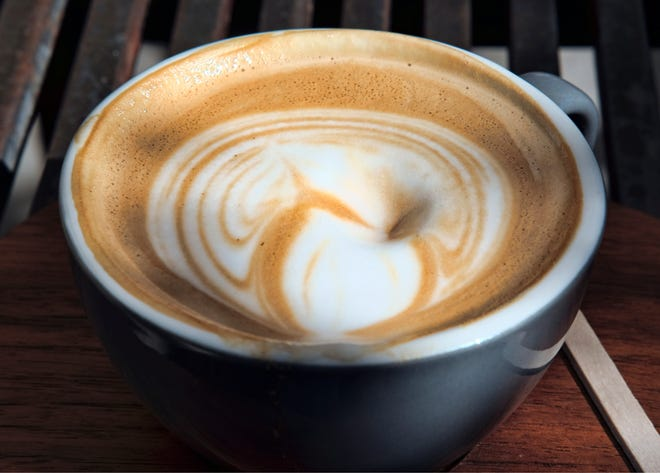 This March 29, 2018 file photo shows steamed milk floating atop a cup of coffee at a cafe in Los Angeles.