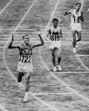 American Bill Mills wins the 10,000 meter race ahead of Tunisian Mohamed Gammoudi and Australian Ron Clarke as part of the Tokyo 1964 Olympic Games on  October 14, 1964. Born on the Pine Ridge Indian Reservation in South Dakota, Mills won the 10,000 meters, still the only American to ever win the race.
