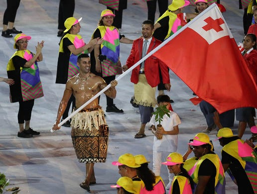 Athletes from Tonga are led by flag bearer Pita Nikolas Taufatofua during the opening ceremonies of the Rio 2016 Summer Olympic Games at Maracana. The moment went viral making the  taekwondo athlete  Taufatofua a sensation. He would repeat as flag bearer, topless, at the Pyeongchang 2018 Winter Olympic Games as a cross country skier.