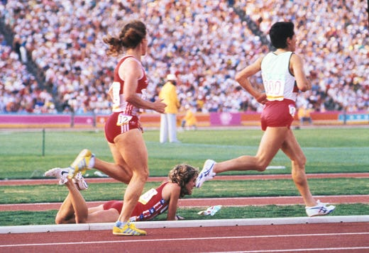 Mary Decker (USA) lies injured on the ground after getting tripped up by Zola Budd (ENG) (not pictured) during the women's 3000m event at Los Angeles Memorial Coliseum during the 1984 Los Angeles Olympics on Aug. 10, 1984.