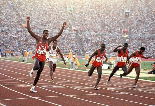 Carl Lewis crosses the finish line with arms in the air, winning the Gold for the men's 100 meters in the 1984 Olympics in Los Angeles, Calif. Concidered one of the greatest track and field athletes of all time, Lewis won the 100, 200 and long jump and went on to help the 4x100 win gold in Los Angeles. He would win a total of ten medals over four Olympics.