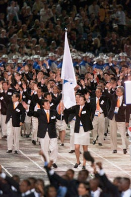 Technically still at war, Olympic athletes from North and South Korea march together as one team into Olympic Stadium during Opening Ceremonies at the 2000 Sydney games. The idea of joining the 180 team members was suggested before a summit of the two Korean leaders who's peninsula has been separated since 1953.