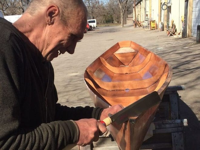 """Jay Haffelder, a volunteer, helps build a canoe, the first step in the Rude Mechs' artistic project to build or buy larger boats to navigate inland waterways for floating """"Great Loop"""" arts residencies."""