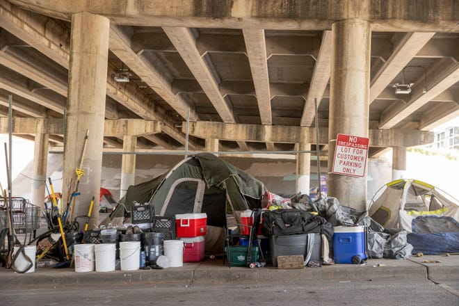 A homeless camp sits under an Interstate 35 overpass in Austin on Wednesday. A proposal for city-sanctioned encampments has hit a roadblock with city staffers rejecting almost all of the 45 locations on a preliminary list of potential sites.