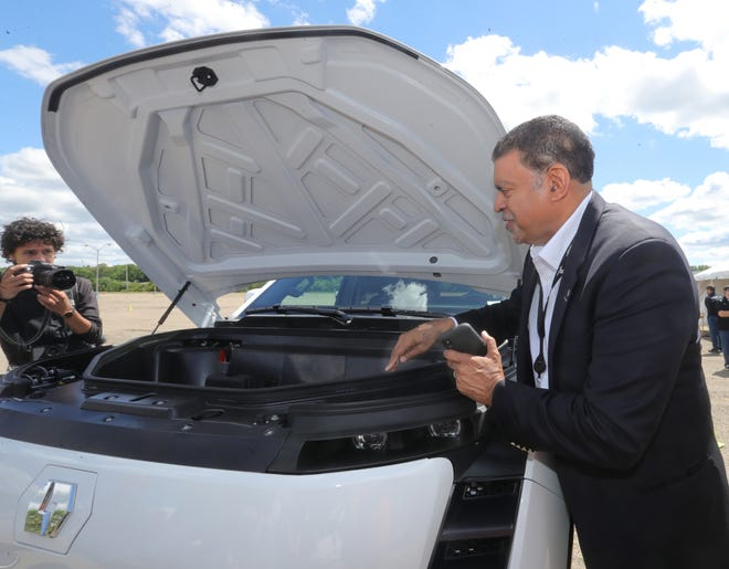 Lordstown Motors VP of Engineering Darren Post points out storage space under the hood of an all electric Endurance pickup during a plant tour on Tuesday in Lordstown, Ohio. The truckis powered by battery packssupplying energy to electric motors in each wheel hub, leaving space under the hood.
