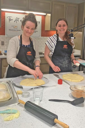 University of Central Oklahoma dietetic student Katelyn Smith, left, assists Taylor Conner, Oklahoma County extension educator, during a virtual bread-making class hosted by OSU and the Oklahoma Wheat Commission. The class featured bread shaping and decorating techniques ideally suited to the Instagram age.