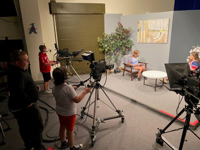 Student campers take use equipment in the Alliance City Schools' Channel 1022 studio at Alliance High School. Campers learned new technology skills during the recent three-day event.