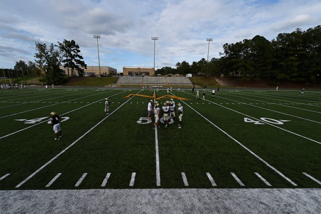 Players practice on the new artificial turf at North Augusta High School on Wednesday, Sept. 23, 2015, after the turf installation was completed that August. The school has seen safety and financial benefits from its installation.