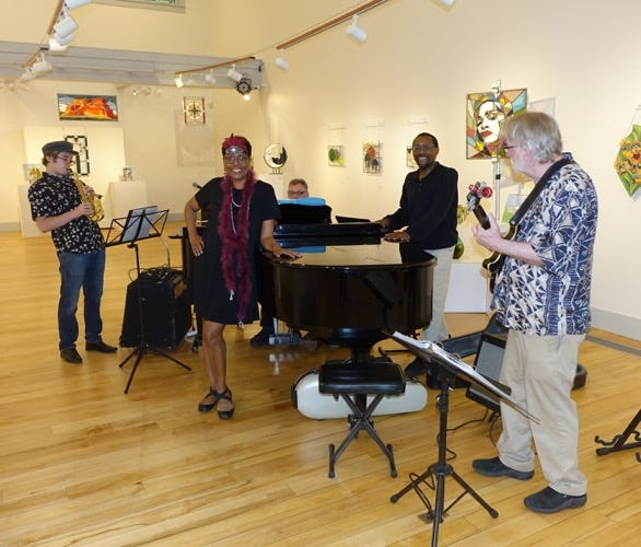 Robin Joyce Miller and Jim Miller in the gallery with live music by Paul Shoemaker and friends.