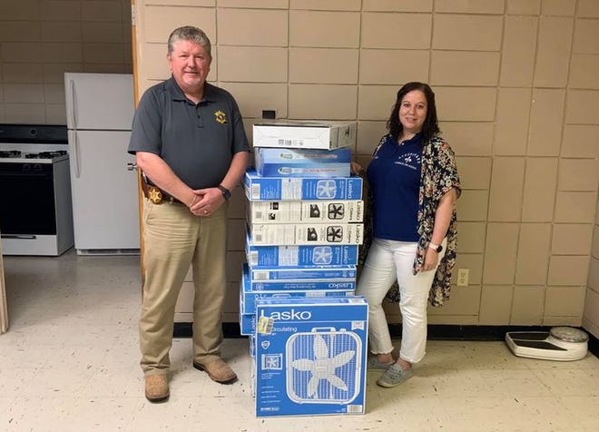 Sheriff Herford with fan donations