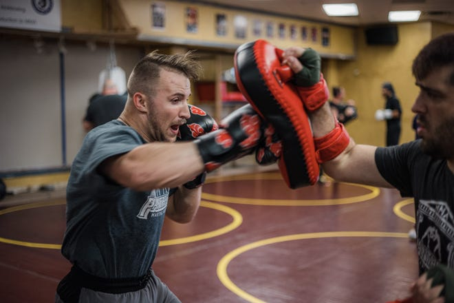 Justin Budd, left, and Damon Hill train for their respective fights at Bartlesville Beatdown II. The event, promoted by Pantheon Martial Arts, is scheduled for Saturday in the former JCPenney space in Washington Park Mall. Doors open at 6 p.m. with fights set to start about an hour later.