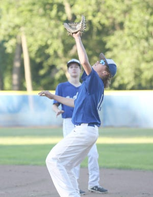 New Franklin first baseman Connor Wilmsmeyer catches a fly ball for the final out against BTC Bank Monday night in Junior Babe Ruth action at Twillman field in Harley park.