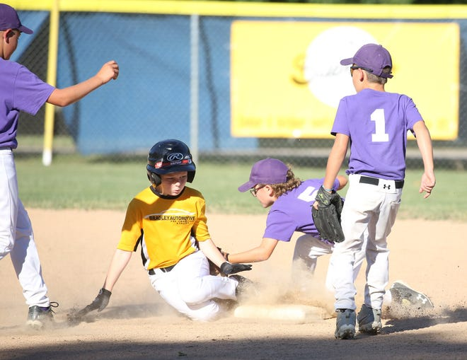 Bradley Automotive's Grayson Tate reaches the bag before Pilot Grove second baseman Walker Mitchell can make the tag in the first inning Tuesday night in Cal Ripken Minor at the COCOBA Ballfield.