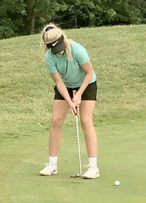 Boonville junior golfer Zoey Lang knocks in a putt on the No. 1 green during the Missouri Junior Tour Hail Ridge on Monday at Hail Ridge Golf Course.