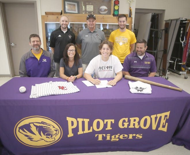 Pilot Grove's Bailey Quint signed a baseball letter of intent with North Central Missouri College in Trenton on Wednesday in the high school commons. Quint, a four-year starter for the Tigers, finished the season hitting .616 with 45 hits in 73 at bats.  On hand during the signing were Pilot Grove baseball coach Joe Vossler, Bev Crawford, Bailey Quint and Pilot Grove Athletic Director Derek Skaggs. (back row, left to right) NCMC assistant coach Ryan Suttenfield, NCMC head coach Donnie Hillerman and Pilot Grove assistant coach Grant Fricke,