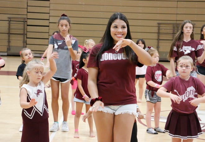 Brownwood Lionette Lauryn Brown, a senior, and other members of the Lionettes dance with younger girls during the Little Lionettes camp at Brownwood High School Wednesday morning. The camp brought about 75 girls ages 3-11 to Warren Gym for the four-day camp.