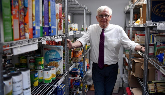 Larry Marsland, CEO of the Lower Cape Outreach Council, stands inside the facility's food pantry on July 12, 2018. The Cape and Islands chapter of SCORE named the council Nonprofit of the Year on June 10, 2021.