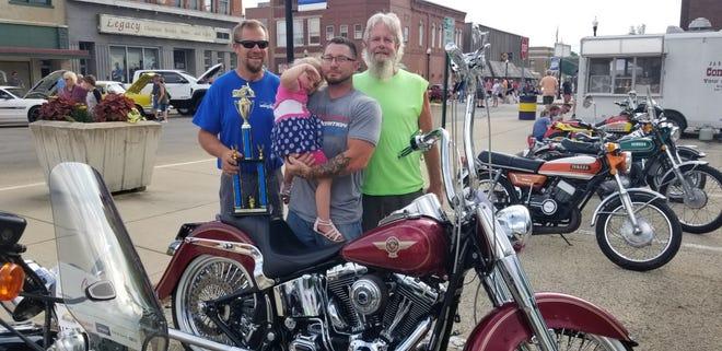 Joe Johnson, Canton, center, received the Best Custom Bike Award with his Harley Davidson Fat Boy,