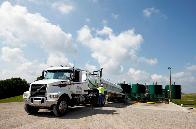 A Pennsylvania semi-truck unloads in fracking waste at the Devco 1 injection well near Cambridge. Ohio is considering draft rules for facilities that handle oil and gas industry waste.