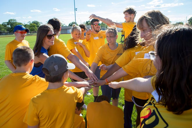 Track and field athletes from Gahanna Special Olympics huddle together prior to their meet against the Columbus team during a Special Olympics Ohio meet at Africentric Early College in Columbus on Tuesday, June 22, 2021.