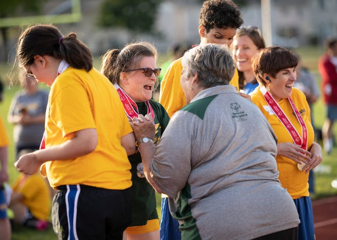Lauren Westbrook jumps for joy with coach Sherrie Andrus as she learns she won a gold medal in the softball throw during a Special Olympics Ohio track meet between the Columbus and Gahanna teams at Africentric Early College in Columbus.
