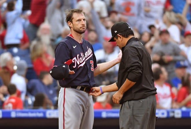 Washington Nationals pitcher Max Scherzer has his belt checked after the first inning Tuesday night. Umpires inspected him three times in the game at the request of Philadelphia manager Joe Girardi.