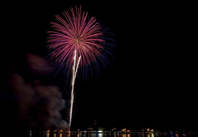 Fireworks explode over Lake Harris at Venetian Gardens in Leesburg on July 4, 2017.