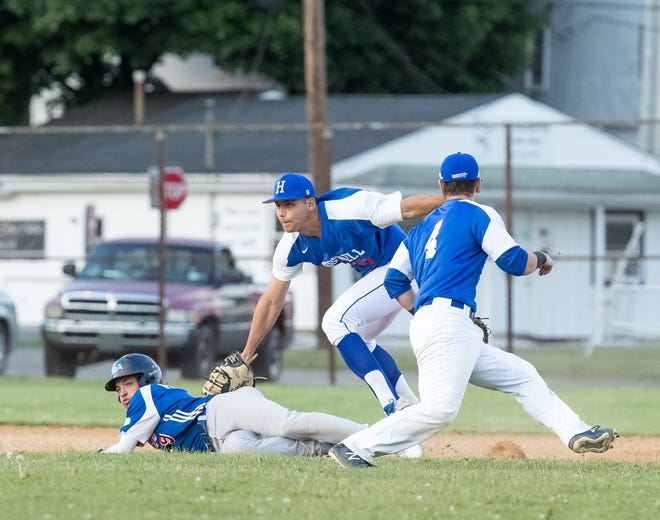 Hornell first baseman Matteo Avallone tags out the Genesee Rapids runner while keeping an eye on the runner at third base.  Hornell went on to tie the game in the bottom of the ninth inning and the game ended in a tie, 3-3.
