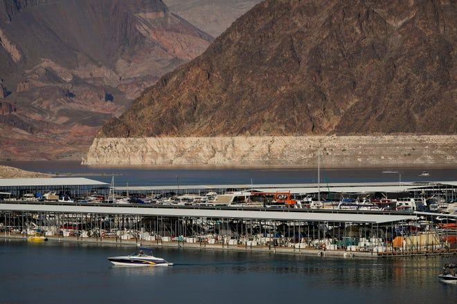 In this Aug. 13, 2020, file photo, a bathtub ring of light minerals delineates the high water mark on Lake Mead at the Lake Mead National Recreation Area near Boulder City, Nev.