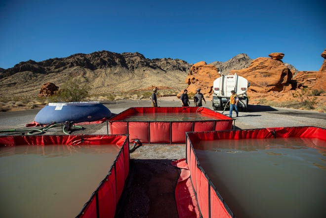 Water is prepared for transport by helicopter during an emergency water haul operation to replenish guzzlers around Valley of Fire State Park, Nev., and beyond on Tuesday, June 8, 2021.