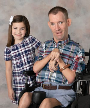 Gianna Capri is pictured with her uncle Michael Alberico who died April 13 at age 42 from complications from a hereditary degenerative disease. The 7-year-old now raises funds in his memory.