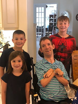 Michael Alberico, who died April 13 at age 42, with niece Gianna and nephews Anthony (rear) and Bobby.
