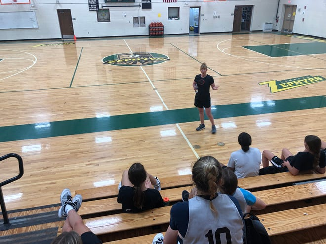 Sara Wood, a 1996 Galesburg High School grad who played basketball for the Streaks, speaks to the members of the Galesburg High School girls basketball program Wednesday morning at Lombard's Erickson Gymnasium.